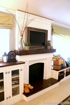 I love this because our House has windows flanking our fireplace an would love to do these built ins. reclaimed wood framed TV with mantel to hide the cords. Style At Home, Faux Foyer, Fake Fireplace, Tv Mantle, Fireplace Ideas, Fireplace Design, Fireplace Mirror, Fireplace Surrounds, Propane Fireplace