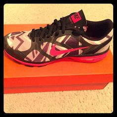 Nike Training Dual Fusion tennis shoes Like New NIKE women's tennis shoes. Zig zag pattern...grey, pink and black...shoes were wore once indoors...JUST DO IT!!...box not included Nike Shoes Athletic Shoes