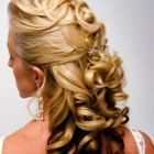 Sophisticated bridal half up curl hair style.