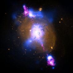 Black Hole-Powered Jets Plow Into Galaxy   NASA