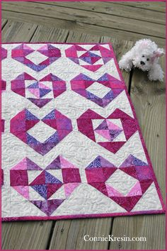 Get this fast and easy tutorial for a baby quilt. It is made with beautiful batik fabrics. #quilting #batiks #diyproject #babyquilt ConnieKresin.com