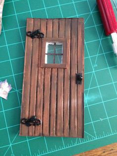 I made a cottage-type door out of foam board and bits of a bracelet I cut up. Miniature Rooms, Miniature Crafts, Miniature Houses, Miniature Furniture, Dollhouse Furniture, Fairy Garden Doors, Fairy Doors, Mini Doll House, Barbie Doll House