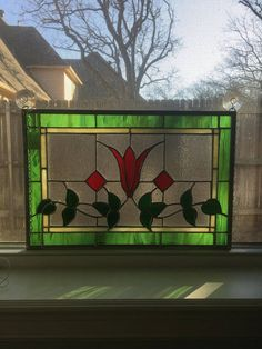 This floral panel has a double border of cream and green and two hooks for hanging. It has a zinc frame and is approximately 13 x 19 inches. Stained Glass Flowers, Faux Stained Glass, Stained Glass Designs, Stained Glass Projects, Stained Glass Patterns, Leaded Glass, Stained Glass Windows, Mosaic Glass, Victorian Stained Glass Panels