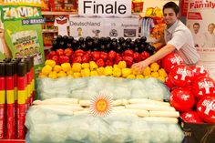 Mathias Danze arranges fruits and vegetables in the colours of the German national flag (TOP) and Argentinian flag (BOTTOM) in a supermarket in Stuttgart, Germany, 11 July 2014. Germany faces Argentina in the FIFA World Cup 2014 final in Rio de Janeiro on 13 July 2014.
