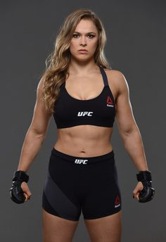 UFC women's bantamweight champion Ronda Rousey poses for a portrait during a UFC photo session at the Sheraton Rio Hotel on July 2015 in Rio de Janeiro, Brazil. Ronda Rousey Wwe, Ronda Jean Rousey, Mma Academy, Ufc Titles, Rowdy Ronda, Ufc Women, Wwe Girls, Fitness Motivation Pictures, Fitness Women
