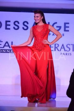 Jacqueline Fernandez attended an event organized by the hair salon 'Dessange' in Mumbai . Jacqueline looked ethereal in a red gown, designed by Amit Aggarwal, as walked the ramp for Dassange. The actress was all smiles as she posed for the waiting shutterbugs.