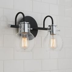The ageless style of the Vintage Arc Shade Bath Collection is synonymous with classic industrial design. The clear glass shades encircle the sockets and appear as though they are floating over the vintage filament bulbs. Vanity Light Bar, Vanity Lighting, Bathroom Light Fixtures, Bathroom Lighting, House Lighting, Bathroom Light Bar, Garage Lighting, Kitchen Lighting, Craftsman Bathroom