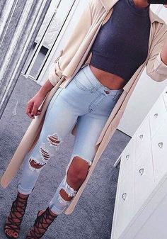 This light blue distressed skinny jeans is a stretchable piece with a mid-rise waist, button and zip fly as frayed detailing for a relaxed fit. Order one here. | Lookbook Store