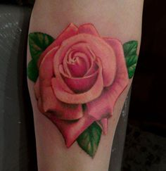 Realistic rose tattoo.