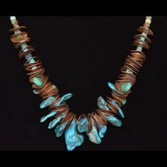 """Southwestern Turquoise Necklace embellished with bronze hammered discs and bronze toggle closure. The piece is titled """"Bisbee."""" The top drilled flat nuggets are probably stabilized turquoise from an unknown source - not from the Bisbee mine."""