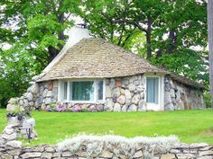 This house is built  by Earl Young.  They are known as mushroom houses they are in Charlevoix, Michigan.  These houses are scattered around the town.  They are so unique & such a pleasure to look at.