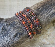 Marbled orange Picasso Czech beads are woven in a pattern, accented with brown and gold; finished with an antique copper button clasp. Great worn alone, or perfect for layering with other bracelets (See Photo #4 shown with coordinating double wrap bracelet, listing: