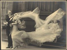 [Wind buffets the bride's veil and train at the wedding of Cyril Ritchard and Madge Elliott, St. Mary's Cathedral, Sydney, September 16, 1935] by National Library of Australia Commons, via Flickr