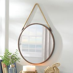 The Metal Rope Wall Mirror is simple yet charming! You can use it as a functional mirror or simply for decoration. The bronze frame and rope hanger provide a nautical charm that fit with any home! Rope Mirror, Round Wall Mirror, Round Mirrors, Round Mirror With Rope, Framed Mirrors, Metal Mirror, Octagon Mirror, Entryway Mirror, Vintage Mirrors