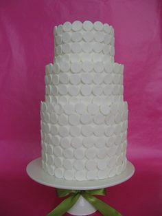 White polka dots are elegant, yet fun on a cake!
