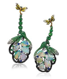 Wendy Yue Dragonfly Earrings. Wendy Yue established her atelier in 1998 and has since become one of the most renowned Hong Kong jewlery designers for creating unique pieces representing the magic of nature.  These one of a kind earrings showcase cabochon opals surrounded by tsavorites, fancy colored diamonds and blue sapphires, in a hand made 18-karat blackened gold setting.