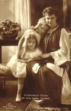 Crown Princess Cecilie with her 2 youngest children, daughters Princess Alexandrine (behind) and Princess Cecilie.