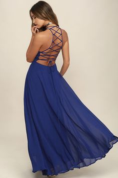 The Strappy to be Here Royal Blue Maxi Dress is your new fun go-to! Dreamy, lightweight Georgette sweeps across a princess-seamed bodice and strappy apron neckline, plus a lacing open back. Full maxi skirt has a bit of elastic at back. Hidden back zipper.