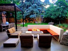 Mile High Landscaping - Modern Patio with Rectangular Fire Pit and TIger Wood Bench. - Denver, CO, United States