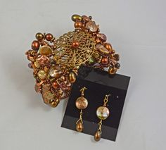 Beadwork by cgm Cuff and earrings using wire work and lots of pearls.