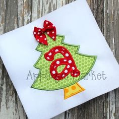 Bring in the holiday spirit with Applique Market's wide selection of special designs like this Christmas Tree Alpha applique. Create a festive Christmas outfit for the special person in your life