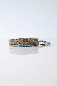 """You'll be sure to stand out with the eye-catching Poa Wrap Bracelet, named for the Swahili word for """"cool.""""With every purchase of a Poa Brass Wrap Bracelet, you give one month of clean water to a family in a Free The Children community overseas, providing access to safe sources of clean water to help them stay healthy and avoid waterborne illnesses. Enter the unique code from your product package at trackyourimpact.com to see the story behind your impact.Each bracelet is handmade with… Mother Of Pearl Buttons, Ladders, Demi Lovato, Bracelet Designs, How To Stay Healthy, Stage, Beaded Bracelets, Shop My, Brass"""