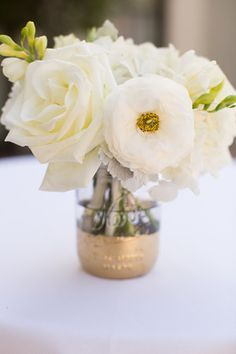 Jenny and Daniel were married at lovely Bel Air Bay Club in Pacific  Palisades. I really enjoyed working with these two — they are a fun and  cute couple!  The following beautiful images are from Christine Chang photography.  Jenny carried a natural design hand tied bouquet with mostly white f