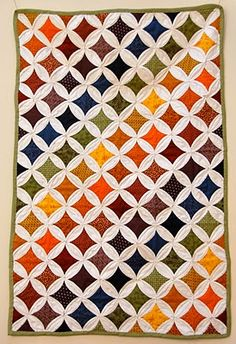Gorgeous rainbow cathedral window quilt by Caitlin GD Hopkins of Vat Public Indifference.