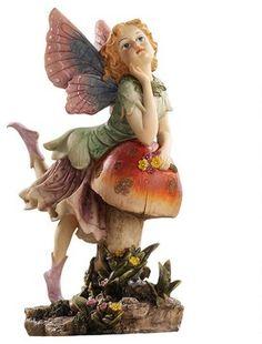 Classy Pixie Garden Fairy Sculpture traditional-garden-statues-and-yard-art