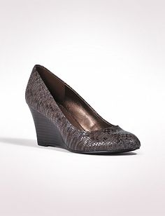 JONES STUDIO ® Faux Snakeskin Wedges  $40.00  sale $19.99  These python-stamped wedges combine a timeless shape with an of-the-moment finish. Faux-python uppers. Imported.
