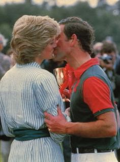 """June 29, 1985: Princess Diana presents Prince Charles with a trophy at a """"Birthright"""" charity polo match at the Guard's Polo Club, Windsor."""