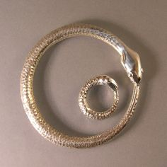 ouroboros ring and bangle. eternal life. never ending circle.