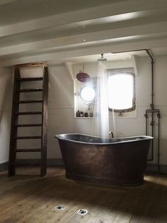 Beautiful. Exposed pipes; the shower aligned overhead; freestanding bath; ladder. http://media-cache-ec3.pinimg.com/originals/b6/b7/4e/b6b74e331c2ddf77bd0c4b593d7ebd24.jpg