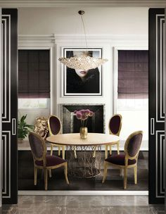 The warm and cozy room pictured above features a true jewel suspended: Eternity Chandelier by KOKET. The set includes a round Enchanted Dining Table that brings enchantment into any Design house