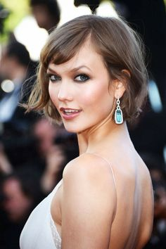 Karlie Kloss, The Architectural Hairstyle at Cannes 2013  The Architectural Hair features a side bang and a side part. The hair flips up at one side rather than curving under. Architectural Hair is best when the strands of hair are visible, rather than a blown out or coiffed look. Typically people of the Architectural Artistic Type look better in dark hair rather than light. For Karlie Kloss' very light skin tone, this hair is quite dark and is very becoming.