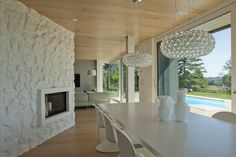 the dining room. Lamps Caboche Foscarini, Chairs Panton Vitra<br>