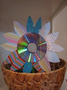Reduce, reuse, recycle!  CD or DVD flowers, fun for all ages.