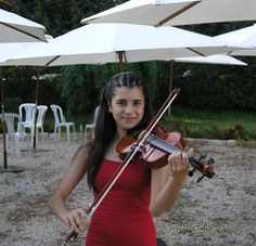 Cute Lebanese girl playing music