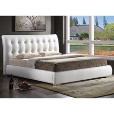 Modern & Sleek Bed with a White Faux Leather Tufted Headboard