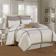 Eight-piece comforter set with contrasting trim and button details.   Product: Comforter2 Euro shams2 Standard shams2 Accent pillowsBedskirtConstruction Material: Double brushed microfiberColor: Taupe and ivoryFeatures:  Tufted comforterOne gold sequined accent pillowOne embroidered accent pillowAccent pillows include inserts Note: Shams do not include inserts