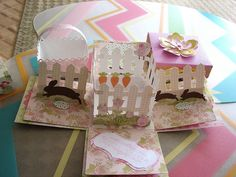 Cricut Easter Double Exploding Box Card. Used Easel technique for the side fences. Used Sweet Tooth Boxes, Wrap it up, Easter 2010 and Create a Critter Cartridges. One of my favorite creation.
