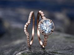 This breathtaking rose gold ring and band set with an aquamarine stone that you'll never want to take off.
