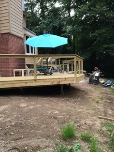 Newly built pressure treated deck with stainless steel cable railings.  Deck built in Madison, CT.