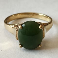Gold plated sterling silver prong set oval green jade cabochon ring... Lot 162