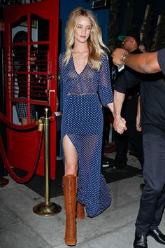 Rosie Huntington-Whiteley in a polka dot maxi dress with slit paired with lace-up boots