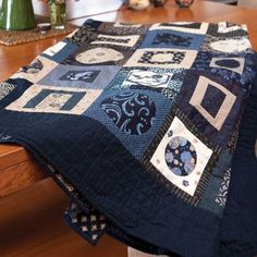 Sew Quilt Styled shot of indigo japanese style quilt folded on table - Make a simple, Japanese-style scrappy quilt with loads of visual impact, from this quilt pattern by Anne Sommerlad, adding contrast between fabrics. Japanese Quilt Patterns, Japanese Textiles, Japanese Fabric, Japanese Style, Circle Quilts, Quilt Blocks, Circle Quilt Patterns, Asian Quilts, History Of Quilting