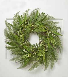 Welcome the spring with vibrant accessories like the 30'' Meadow Spring Wreath. This leafy arrangement has a vibrant assortment of ferns. The ferns are designed in lifelike hues with delicate textures
