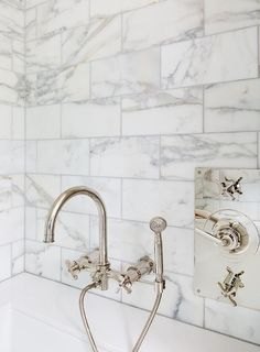 Absolutely gorgeous bathroom boasts a gooseneck tub filler by Waterworks mounted on a marble tiled wall placed over a sleek bathtub. Waterworks Bathroom, Bathtub Tile, Bathroom Taps, Master Bathroom, Wall Mount Tub Faucet, Bathroom Wall Decor, Bathroom Ideas, Bathtub Decor, Bathroom Remodeling