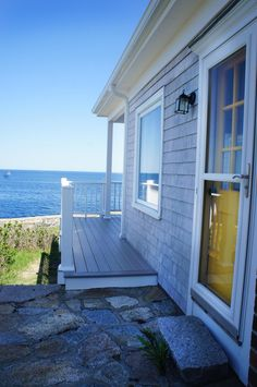 PIGEON COVE: This waterfront vacation rental home overlooks Rockport's picturesque Pigeon Cove harbor with unobstructed 180 degree views of the Atlantic, Sandy Bay, and the twinkling lights of the village of Rockport. The location of the home is ideal, away from all the hustle of town, but a 10 minute walk to everything you might want, including Front Beach and Back Beach, restaurants, galleries and shops. Vacation Rental | Rockport, MA United States - Pigeon Cove | Atlantic Vacation Homes
