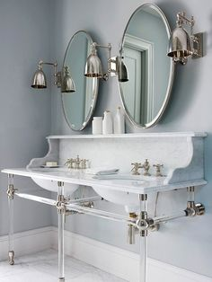 Marble in the Bathroom - Looking for the ultimate in luxury?  How amazing is this retro inspired vanity washbasin with spectacular Lucite legs – stunning!
